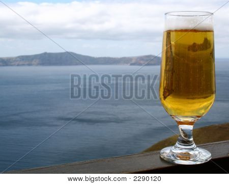 Glass Of Bear In The Cafe Above The Santorini'S Caldera