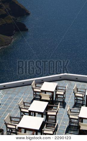 A Summer Cafe Over The Santorini'S Caldera