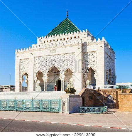 The Mausoleum Of Mohammed V Is A Historical Building Located On The Opposite Side Of The Hassan Towe