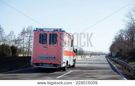 Achern Germany - Feb 18, 2018: Fast Driving In Front Deutsches Rotes Kreuz Ambulance On German Rural