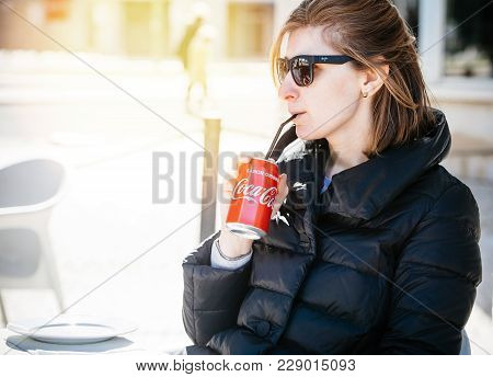 Lisbon, Portugal - Feb 10, 2018 Beautiful Fashionable American Woman Drinking Coca-cola Soda Can Thr