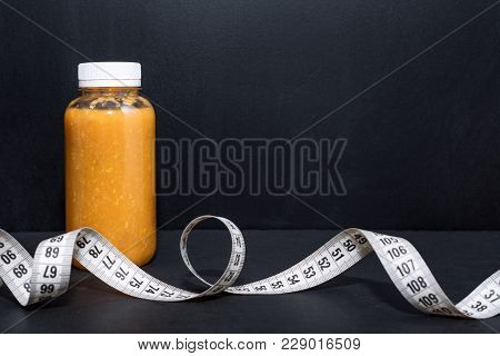 Detox Drink With Dumbbells And Measuring Tape. Free Space For Text. Concept: Detox And Fitness, Diet