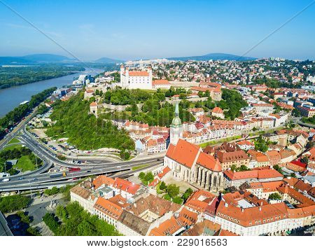 Bratislava Castle Or Bratislavsky Hrad And St. Martin Cathedral Aerial Panoramic View. Bratislava Is