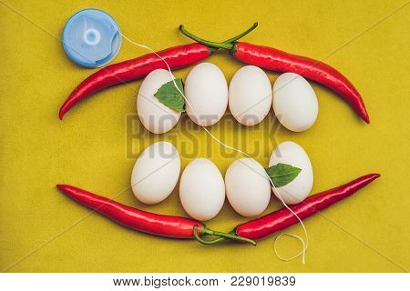 Eggs And Red Peppers In The Form Of A Mouth With Teeth. Leaves Are Stuck To The Teeth And Dental Flo