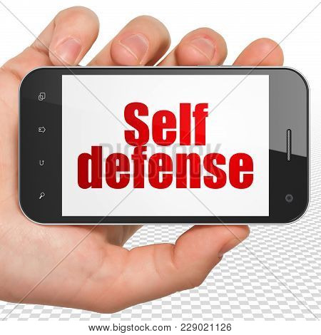 Protection Concept: Hand Holding Smartphone With Red Text Self Defense On Display, 3d Rendering