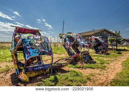 Conway, Texas, Usa - May 12, 2016 : Bugg Ranch On Route 66. Bugg Ranch Is A Public  Art Installation