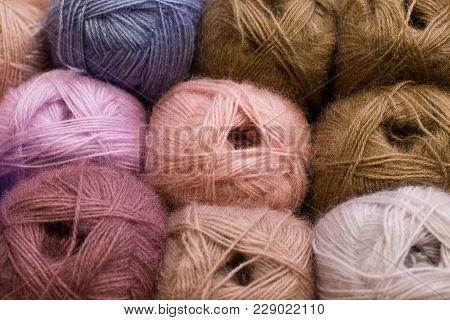 Knitting Needles, Colorful Threads, Beige Colors. Selection Of Colorful Yarn Wool On Shopfront. Knit