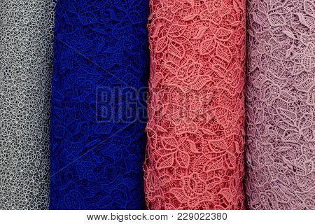 Colorful Swatches Of Lace Fabric On Shopfront. A Lot Of Fabric Rolls. Bolts Of Lace Fabric Blue, Pin