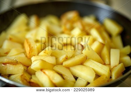 Cooking Of French Fries Or Fried Potatoes In A Frying Pan Close Up