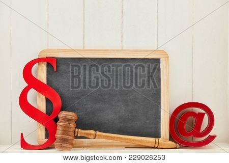 IT law and media law background with email symbol and an empty blackboard