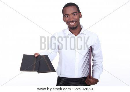 Waiter giving menus