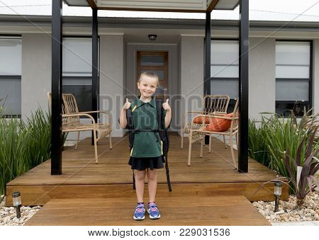 6 Or 7 Years Old Female Child Smiling Happy Giving Thumbs Up Carrying School Backpack Wearing Studen