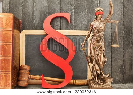 Law Law Justice concept with symbols like Justitia Paragraph and Judge Hammer