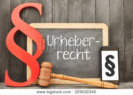 German word Urheberrecht (copyright law) as media law concept with smartphone