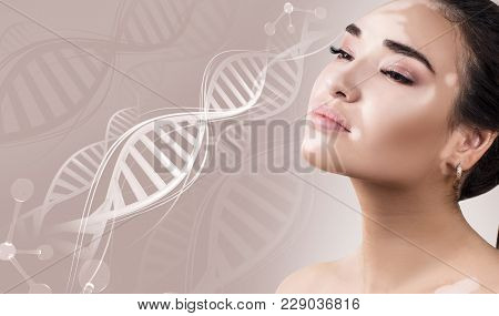 Young Sensual Woman With Vitiligo Disease In Dna Chains Over Beige Background.