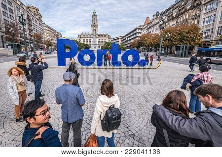 Porto, Portugal - December 8, 2016: Tourists In Front Of Large Porto Sign At Avenue Of The Allies Wi