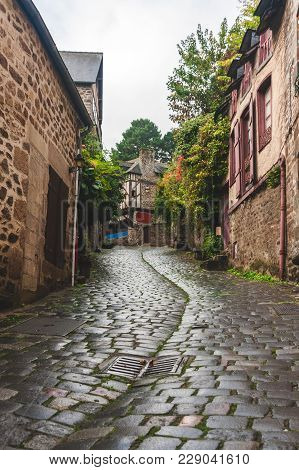 Pedestrian Medieval Cobbled Road Leading Upward To Traditional Half-timbered Houses In Old Town Of D