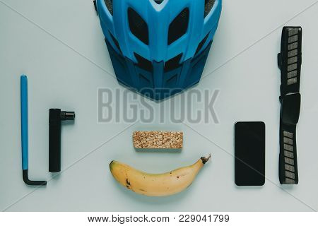 Cycling Accessories And Food Prepared For A Bike Ride, On Blue Background.