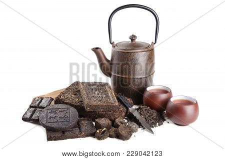 Various Black Compressed Pu-erh Chinese Tea With Special Knife, Cups And Tearot On White Background