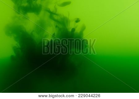 Colorful Water Green Pigment Background. Liquid Ink Spalsh