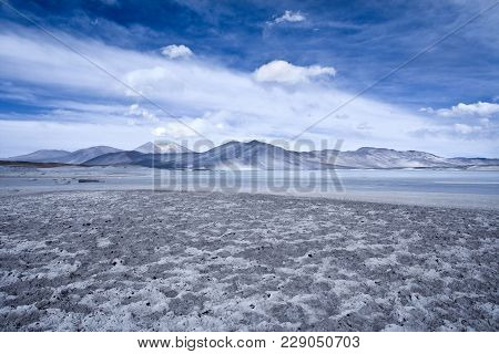 Salar De Aguas Calientes (spanish For Hot Waters Salt Lake) And Lagoon In The Altiplano (high Andean