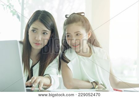 Women Working Together With Intention And Seriously In The Office Interior.