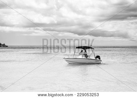 St. Johns, Antigua - March 05, 2016: Motorboat With People On Shallow Blue Sea Or Ocean Water On Clo