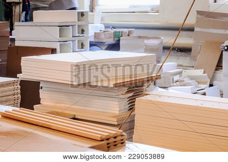 Stacks Of Wooden Materials Inside A Furniture Factory