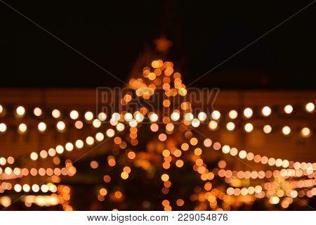 Illumination Of Christmas Market In Salzburg, Austria. Christmas Tree Bokeh Lights
