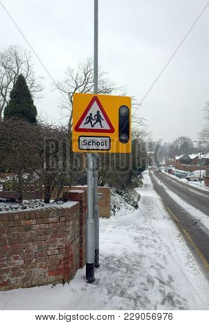Bracknell, England - March 01, 2018: School Children Crossing Warning Sign Next To A Foot Path And R