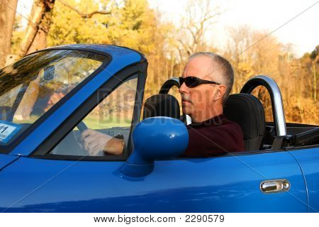 Mid-Life Crisis - Man In A Blue Convertible