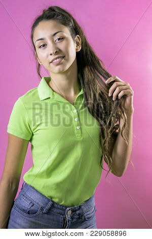 Portrait Of Young Beautiful Latin Woman Pulling Her Hair Tail
