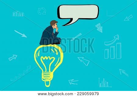 Businessman Sitting On A Lamp And Thinking About A New Idea