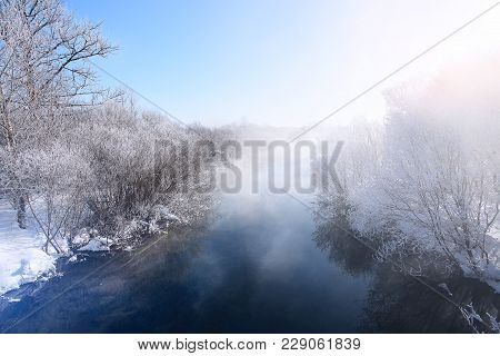 Winter Landscape On A Frosty Day. The Mist Over The River. Frost And Sun.