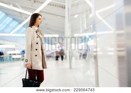 Well Dressed Young And Cute Businesswoman Walking