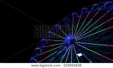 A Ferris Wheel Caught The Corner Of My Eyes, I Captured The Tall Heights Of The Wheel As It Reached