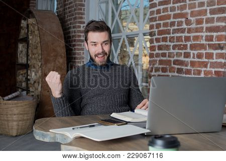 Smilling Man Freelancer Raising Hand In Yes Gesture, Celebration Victory, Looking On Laptop Computer
