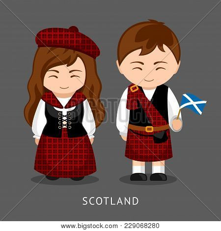 Scots In National Dress With A Flag. Man And Woman In Traditional Costume. Travel To Scotland. Peopl