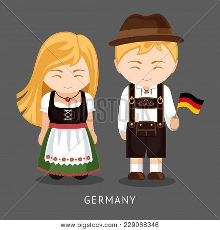 Germans In National Dress With A Flag. Man And Woman In Traditional Costume. Travel To Germany. Peop