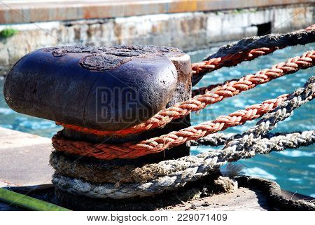 Mooring Rope Of A Large Ship In The Port Wrapped With A Mooring Rope
