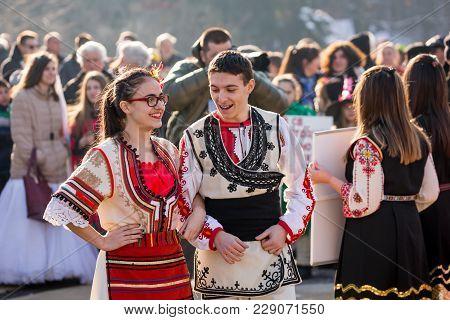 Pernik, Bulgaria - January 26, 2018: Two Dancers In Bulgarian Folk Costumes, Girl And Boy Talk And P