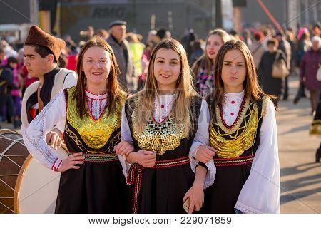 Pernik, Bulgaria - January 26, 2018: Three Girls Dancers In Bulgarian Folklore Costumes Pose For The