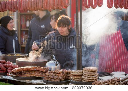 Pernik, Bulgaria - January 26, 2018: Variety Of Delicious Pork Meals, Kebab, Sausages Are Being Sold