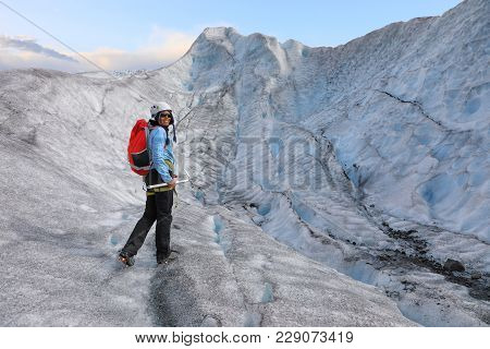 Woman Climber Standing In The Cleft Of The Falljokull Glacier (falling Glacier), Iceland