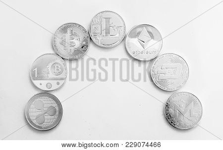 Silver Coins Of A Digital Crypto Currency - Litecoin Bitcoin Ethereum Monero Ripple Dash On The Whit