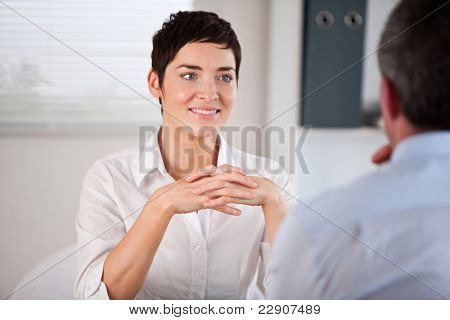 Candidate listening to her future manager in his office