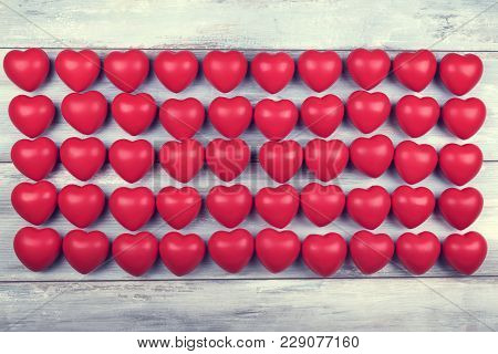 Fifty Red Plastic Hearts In Line. 4th Of Jully