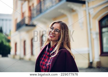 Cheerful Pretty Young Lady Holds His Glasses Her Hands And Smiles At His Interlocutor.girl Wearing S