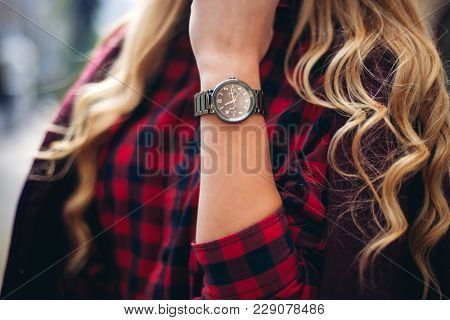 Elegant, Trendy Outfit Closeup Of Wrist Watch On The Hand Of Stylish Woman. Fashionable Girl On The
