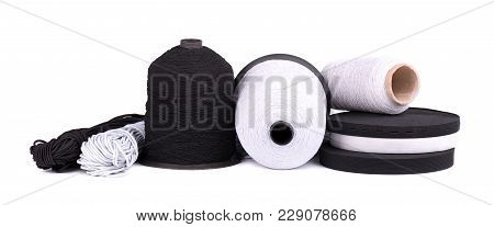 Black And White Sewing Elastic Band Isolated On White Background. A Variety Of Elastic Bands For Clo
